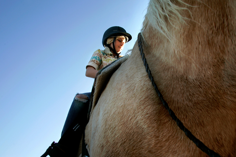 Lauren Mahoney, 9, of Lake Stevens, rides Sweet Pea on October 20, 2010 at the Mountain River Youth Ranch, a nonprofit that works out of the Faith Equestrian horse farm in Snohomish. The nonprofit pairs at-risk children with horses.