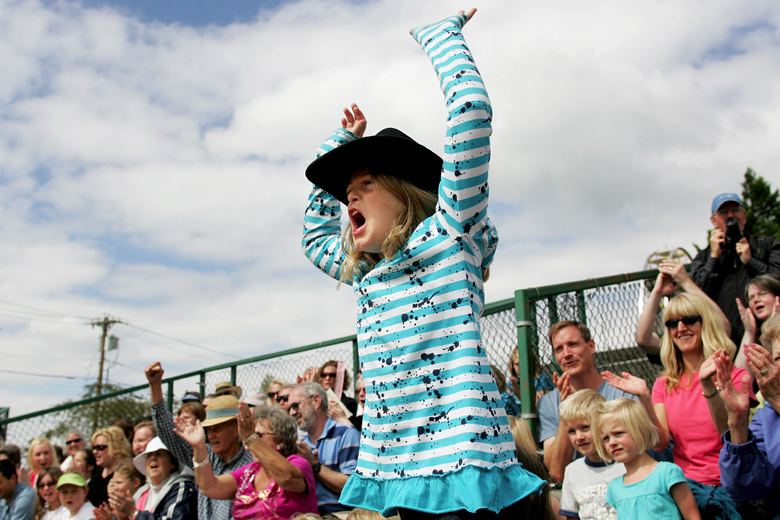 Laura Feir, 8, of Shoreline, cheers for Sloppy Joe, a pig, during the All-Alaskan Pig Races at the Evergreen State Fair on August 28, 2010.