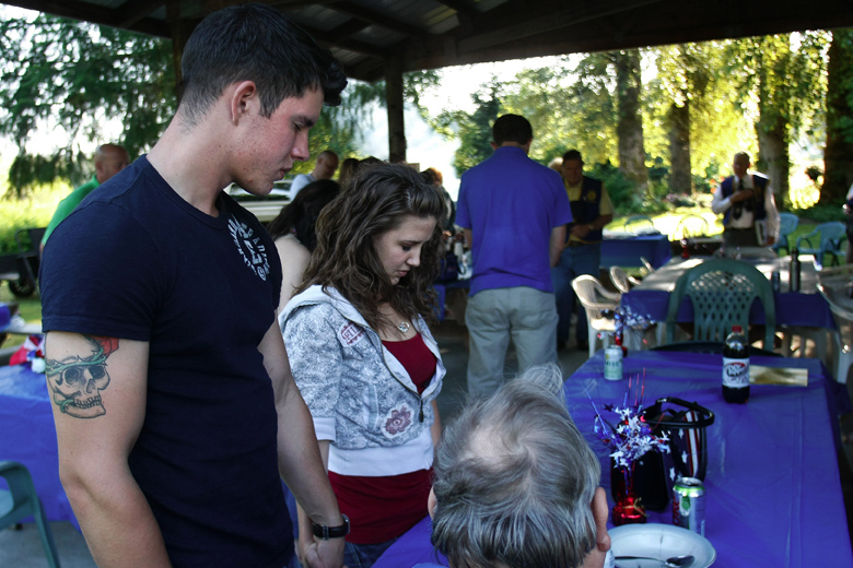 Jordan and Whitney pray with others at start of the American Legion picnic. Jordan became a member of the Lake Stevens post of the American Legion a few days afterward.