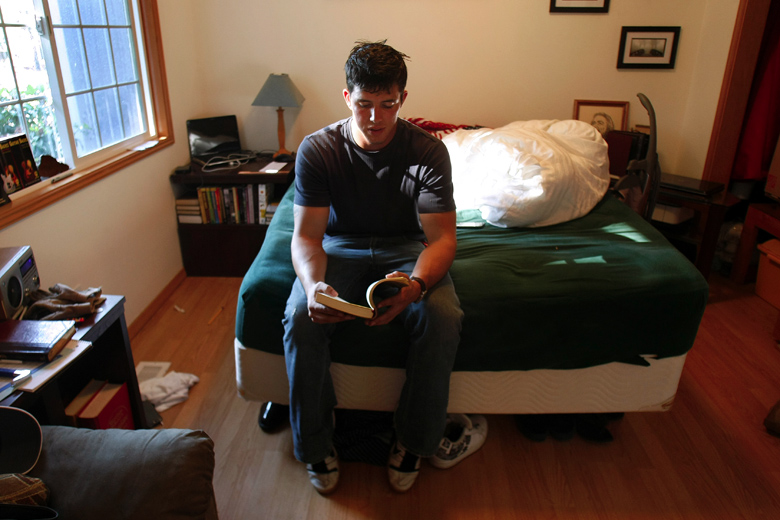 "Jordan flips through his journal of poetry in his bedroom at home, the same bedroom he grew up in. During his tours in Iraq and Afghanistan, Jordan wrote poetry on any scraps of paper he could find, and when he got home, he compiled them all in a journal. Writing brought him comfort, and though reading the poems now brings up the emotions he felt when writing them, they are, he says, ""an important piece of my history."" Looking back at them now, ""I feel a sense of closure. In light of knowing where I've been and where I'm going, there's hope."""