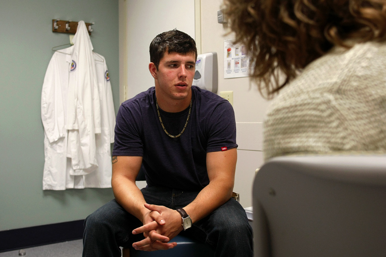 A few months after he returned home, Jordan was diagnosed with Post-Traumatic Stress Disorder and told that he had sustained a Traumatic Brain Injury (TBI) from when a 40-pound IED exploded beneath the MATV he was driving. He had a TBI screening with Dr. Lisa McPeak in August, shown here, at the Center for Polytrauma Care at the VA Puget Sound Health Care System in Seattle. The appointment was aimed at determining the level of severity of the TBI.