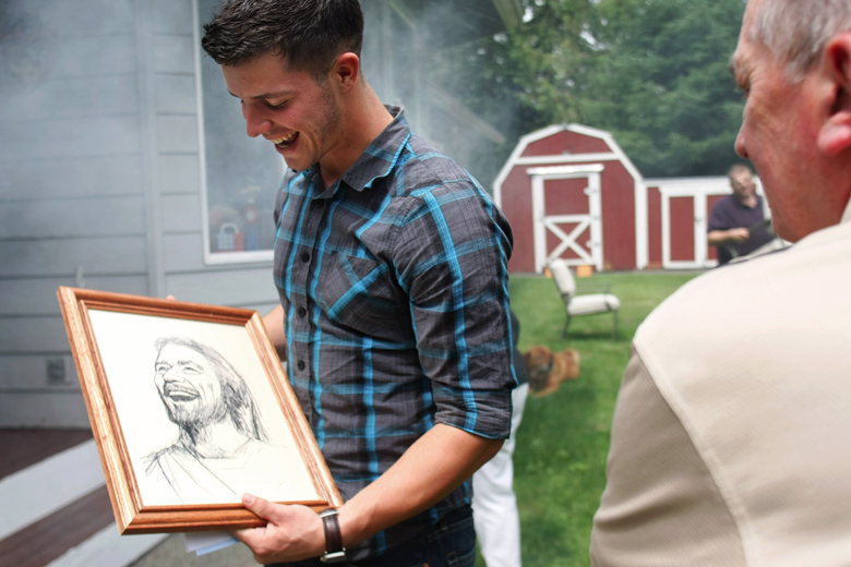 "Jordan's faith has grown increasingly more important to him since his return, and has helped him find his footing again in civilian life. It has, Jordan says, played ""a crucial part in getting back to the old me.""  Here, Jordan reacts to the ""The Laughing Christ"" portrait, a gift given to him by Lew McAllister, at right, a family friend and a man whom Jordan views as a role model."