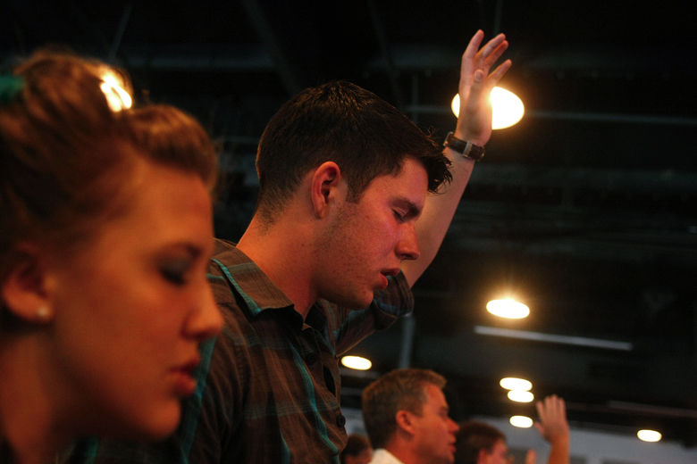 "Jordan and Whitney pray during a Sunday service at Canyon Hills Community Church in Bothell. ""There are safe ways to live our lives,"" said. ""In a failing economy, (in) financial struggles, in hardships, in relationships, there are so many different ways which we settle, day after day. We settle for less ... We would take not necessarily the wrong way, but the easiest, or the path of least resistance. And so many times we travel the path of least resistance because it's the easiest one to go down. Or because it's the one that hurts the least."" But ""out of hardship is born perseverance, and it produces only great things in your life."""