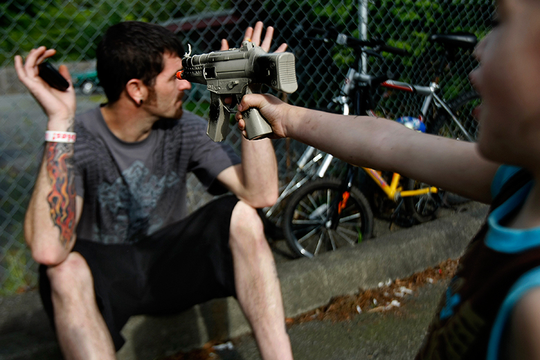 """Liam points a toy gun at his dad outside their Everett apartment on June 21. When Torrance got the kids back, he said he was """"overwhelmed. Stressed. I didn't know how to deal with them."""" That struggle continues daily for him."""