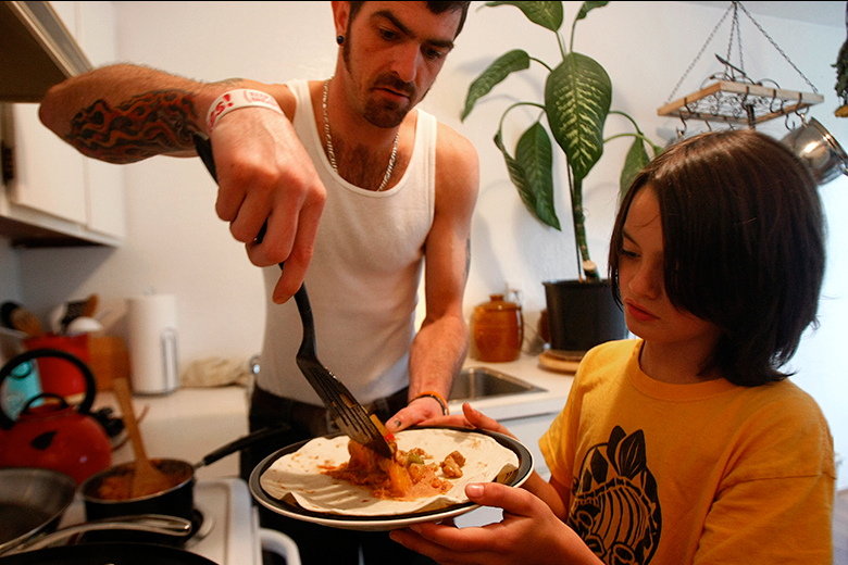 """Slowly, though, Torrance is establishing a sense of normalcy. Here, he serves up dinner to Kaeden at their Everett apartment one evening in June. """"When CPS throws hoops at you, you jump through them. If they lit them on fire, I'd jump through them even quicker,"""" Torrance says about all that was required of him to get his kids back."""
