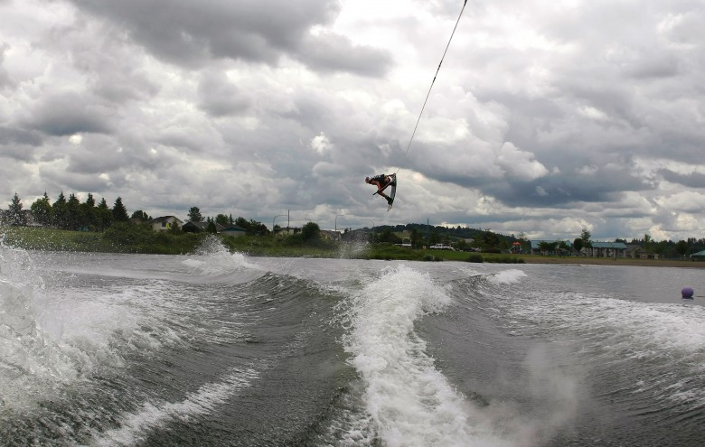 Adam Errington of the United States competes in Heat 1 of the Professional Men's Qualifying Round of the MasterCraft Pro Wakeboard Tour on Lake Tye in Monroe on Friday, July 8, 2011. The Finals are on Saturday.