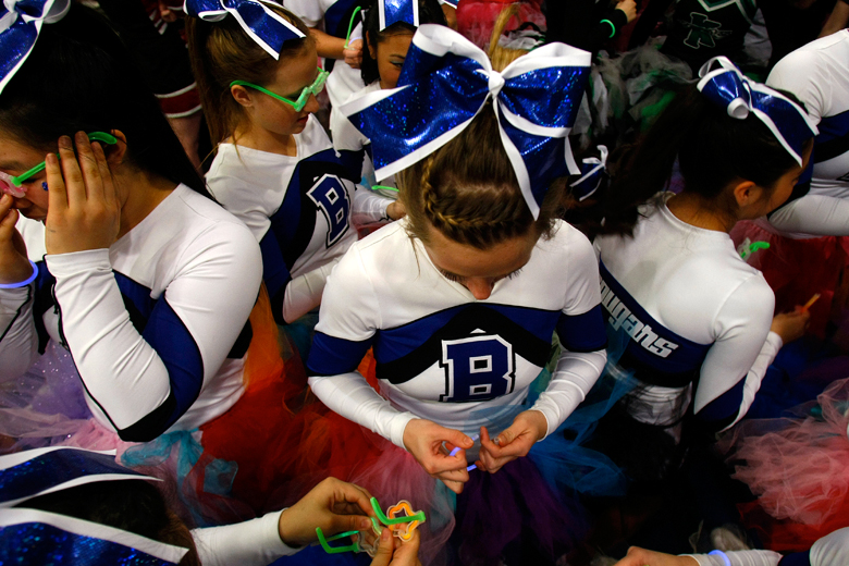 Cheerleaders on the Bothell squad gather together in costume as they wait to participate in the parade following the 2012 Washington State Cheerleading Championships at Comcast Arena on Saturday, February 4, 2012.