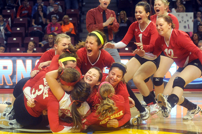 The Deer Creek-Mackinaw volleyball team celebrates their victory over Dakota after scoring the winning point during Saturday's Class 2A State Championship match at the Redbird Arena in Normal on November 10, 2012. The state title was the first for Dee-Mack High School.