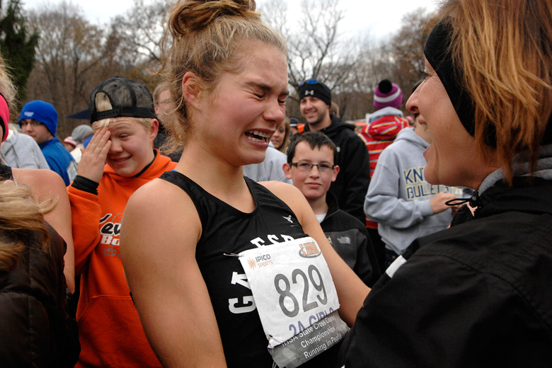 Stephanie Saey (829) of Galesburg is overcome with emotion as she is congratulated by family and friends after placing second in the 2A Girls Race during the Cross Country State Finals at Detweiller Park in Peoria on November 3, 2012.