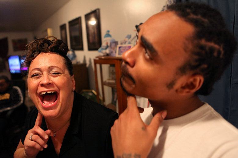 Harris jokes around with her son Dante Dothard, 22, at her South Peoria home on Thursday, December 13. When Dothard was 3 years old, Harris gave birth to her youngest child, Shawniece Sephus, with cocaine in her system. DCFS took Sephus and Dothard, as well as Harris' oldest son, Jeremiah Dothard, away from Harris, and put them into foster care. Dante eventually came back to live with Harris, and now he says he's learned from her experiences.