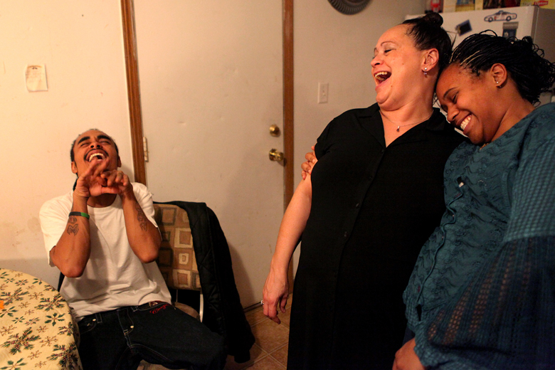 Cassie Harris laughs with her son, Dante Dothard, 22, and daughter, Shawniece Sephus, 18, at her South Peoria home in December.