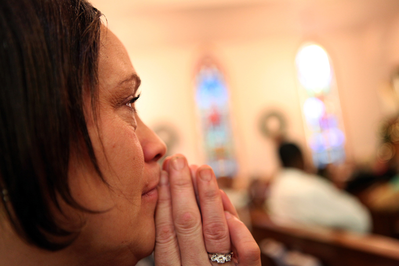"""Cassie Harris listens during a Sunday morning church service at Christ Lutheran in South Peoria. """"I know now, more, with being sober, that I have a job. God has put me on this earth for a reason. And I have a purpose."""""""