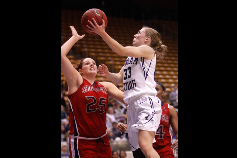 Haley Steed (33) of BYU shoots around Carli Rosenthal (25), left, of Saint Mary's in the second half during the game between BYU and Saint Mary's at the Marriott Center in Provo on Thursday, January 31, 2013.
