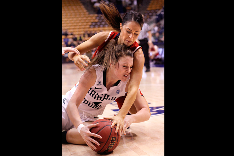 Kim Beeston (4), bottom, of BYU fights for the ball with Mia Greco (21), top, of Saint Mary's in the second half of the game between BYU and Saint Mary's at the Marriott Center in Provo on Thursday, January 31, 2013. BYU won the game 66-58.