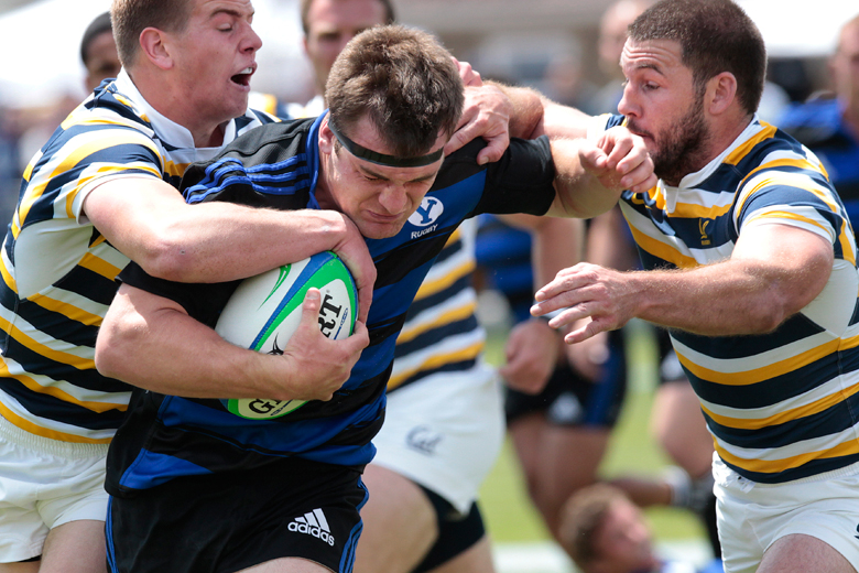Ryan Roundy of BYU tries to shake off California players as he works his way up the field with the ball during the Varsity Cup National Collegiate Rugby Championship Game at BYU's South Field in Provo on Saturday, May 4, 2013. BYU defeated California in the last seconds of the game, 27-24.