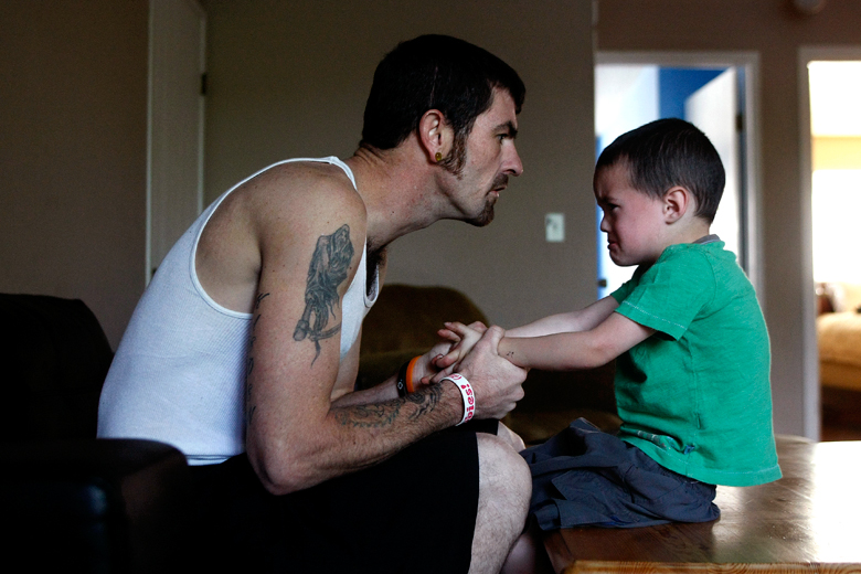 "Aaron Torrance tries to discipline his son, Liam, 3.  After 15 years of escalating drug use - marijuana, meth, cocaine, OxyContin, and finally heroin - Torrance, 30, has gotten clean. He has regained sole custody over his two sons, Kaeden, 9, and Liam, after they were taken from him and their mother, who still struggles with drug use. When Torrance initially got the kids back, he said he was ""overwhelmed. Stressed. I didn't know how to deal with them."" That struggle continues daily for him, especially with Liam, who has not had a stable parental figure for the majority of his life. Torrance's attempts to establish himself as one is often met with resistance."